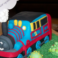Thomas Train NOT an easy cake!!! Vanilla, covered with fondant. Still looking for the perfect, moist, easy to carve cake recipe. Had to do the cake 3 x...