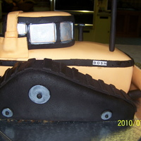 Bulldozer Yellow bulldozer stacked and carved. Covered in fondant.
