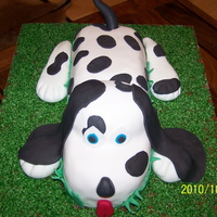 Dalmation Vanilla cake carved and stacked. Covered in fondant.