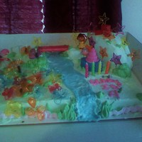 Gabbys Dora Cake  made this cake for my grandaughter ...had a few mishaps...but all in all turned out well....she loves the gelatin flowers and stars and...