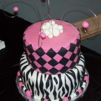 "Zebra And Checker Cake For a sweet 16 birthday. 8"" and a 10"" cake, marble and chocolate flavors with chocolate fudge filling. Black fondant was sooo..."