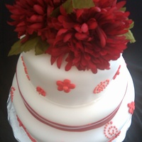 White And Red Cake This was a 3 teir cake withchocolate, yellow and white flavors. I used Red fondant and cut out flowers . The flowers on the top i found at...