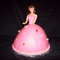Barbie Shaped pan was used for the skirt. The Shirt was a pain to stick to the barbie. Overall, it was a pink dress with roses, just what the...
