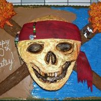 Pirates Of The Caribbean Skull Cake  I made this Pirates of the Caribbean Skull cake freehand for my grandson's 10th birthday. The skull and torches sat on a full sheet...