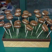Football Cake Balls These are cake balls shaped into footballs dipped in milk chocolate. These went along with a football field cake I did.