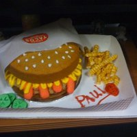 Round Dog Cake This cake is a replica of a Round Dog from a restaraunt in El Paso, TX called Chico's Tacos. A friend of mine had just kind of...