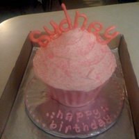 Big Pink Cupcake I did this big cupcake for a my friend's daughters 4th birthday. All he told me was that everything had to be pink. So i ran with that...