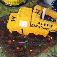 Alex's Dump Truck Cake  I made this for my nephew's first birthday. I baked two loaves of pound cake. I used one loaf for the bed of the truck, and I cut the...