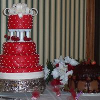 Michelle's Wedding Cake  This cake is red with white trim because the bride's dress was white with red trim. I used Marshmallow Fondant (MMF) on the entire...