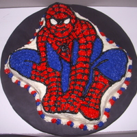 Spiderman Character Cake wilton cake pan used to make this spiderman cake. cream cheese frosting anda tilling