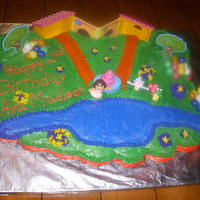 Dora Scene Cupcake Cake My daughter loves doing the kid cakes and so far everyone has been very happy. this dora scene is made on 36 cupcakes.