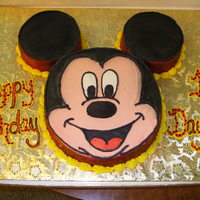 Mickey Mouse Chocolate and strawberry cake with buttercream icing.