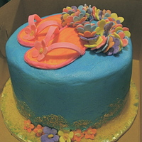 Luau My camera didn't seem able to take a good picture of this cake; the colors are all washed out. Shoes and lei are made of gumpaste. I...