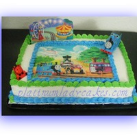 Thomas And Friends This was a cake for a 4 year old boy...I didn't realize I put the wrong age on until I was getting ready to take the cake inside &...