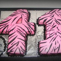 Zebra Pink & Black Numbers This was my first time carving numbers ... Each number was craved from a half sheet cake then covered in fondant Didn't have a stencil...