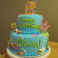 Spongebob Cake! This is a 2 tier cake with vanilla and chocolate cake. All buttercream icing, white chocolate shells, and Spongebob, Patrick, and the...