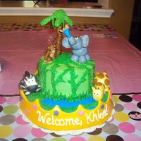 Queen Of The Jungle Baby Shower Cake Buttercream icing with fondant animals, baby, crown, and tree.