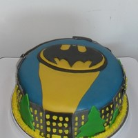 Batman This is a white cake with buttercream frosting and then covered completely with fondant. I made this cake for a friend's sons birthday...