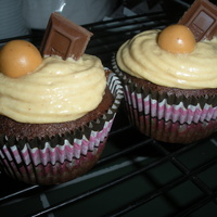 Chocolate Peanutbutter Chocolate banana cupcakes with peanutbutter frostin topped witha hershy bar and a reeses candy