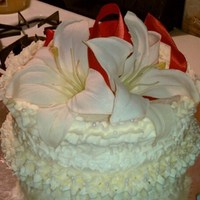 Anniversary Cake White cake with pure white butter cream. This was an exact replica of a friends top wedding teir.