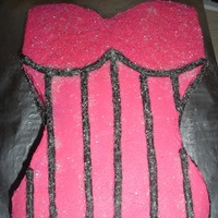 Pink Corset Cake Italian Creme cake layered with a fresh strawberry cake and banana frosting