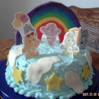 Care Bears Cake  Pretty new at this caking thing but really enjoy it. Made this for my daughters 1st birthday. Thought it turned out pretty good actually....