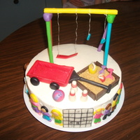 A Grandma's Birthday Cake Made this for my mom's birthday. Most of what her favorite things are revolves around grandkids and neighbors kids. White cake,...