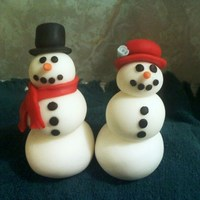 Snow Couple Fondant snowman and snowgirl I made for a globe cake Im making :) TFL
