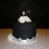 Black Birthday Cake I made this for my friends Bday. Vanilla cake with chocolate buttercream. Black MMF, white fondant roses. TFL