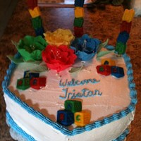 Baby Block Cake Primary color hexagon coconut cake with white choc truffle filling, coconut mousse filling with coconut icing. Baby blocks and baby word...