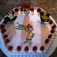 Dr Suess/pirate Cake Hexagon shaped dark chocolate truffle raspberry cake with white chocolate filling and raspberry cream cheese filling topped with whipped...