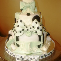 Baby Shower This was a sample cake. MMF bottom tier, buttercream top layer. fondant accents and chocolate rattle topper