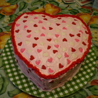 """cake For My Valentine"" This is a two layer strawberry cake with bc icing tinted pink with red trim and heart shaped red, pink and white sprinkles....made..."