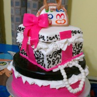 Pink And Black Boxes Cake The cake is buttercream fronting the lids and purse is crispy treats cover in mmf