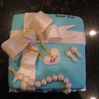 Tiffany Box Cake Made this for a friends mom. She loves to shop. Its an almond cake with almond butter cream and almond flavored MM fondant. I really...
