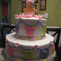 Baby Shower Top tier is chocolate cake with chocolate fudge filling and bottom tier is chocolate cake with fresh strawberries.