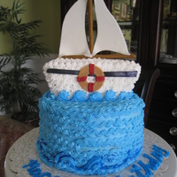 Sailboat This is a sail boat birthday cake i made for a friends dad.It's a banana cake with a banana pudding filling and vanilla butter cream....