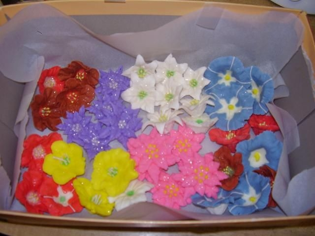 Mix Flowers This flowers are watermelon flavor royal icing. I was practicing. They taste and smell good, yummy!
