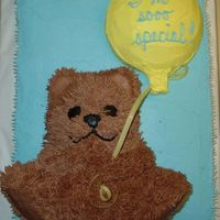 Teddy Bear W Balloon Shower Cake I made this for a friend who'd adopted a baby from Russia. I used the Wilton stand up bear pan and sliced off most of the back to lay...