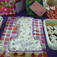 Cupcake Cake For Ivy's First B-Day I made this in late June for my granddaughter's first birthday. It was humid and about 110 degrees and the party was outside in a park...
