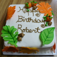 Fall Birthday Cake Fondant and gumpaste leaves, pumpkins and acorns.