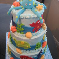 Under The Sea Baby Shower Cake Bottom tier is Triple Chocolate with Fudge Filling, Middle tier is French Vanilla with Vanilla Buttercream Filling. Top tier is Red Velvet...