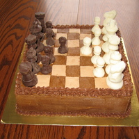 "Chocolate Chess Cake 8"" square cake, chocolate molded chess pieces on a buttercream chess board"