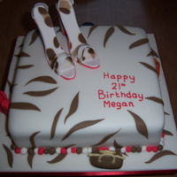 Shoe Cake Modelling paste shoes with animal print design and sugarpaste handbags