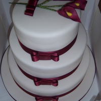 3 Tier Stacked Wedding 3 tier stacked wedding cake with cala lillies placed on top