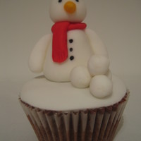 Snowman Cupcake Fondant covered cupcake with fondant snowman