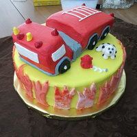 "Fire Truck Cake This cake was huge. On a 12"" round. Used loaf pans to make the fire truck. I struggled a bit with the truck as you may can tell...."