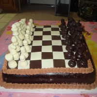 Chess Cake Fondant covered chocolate cake with white and dark chocolate pieces and squres