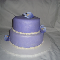 Purple Passion I did this for a co workers anniversary. Its chocolate, vanilla and strawberry cake with butter cream and mm fondant Accented with sugar...