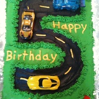 Road Cake This was for a five-year-old little boy. It is all buttercream icing. The cars and the cones are toys. I found a lot of inspiration here on...
